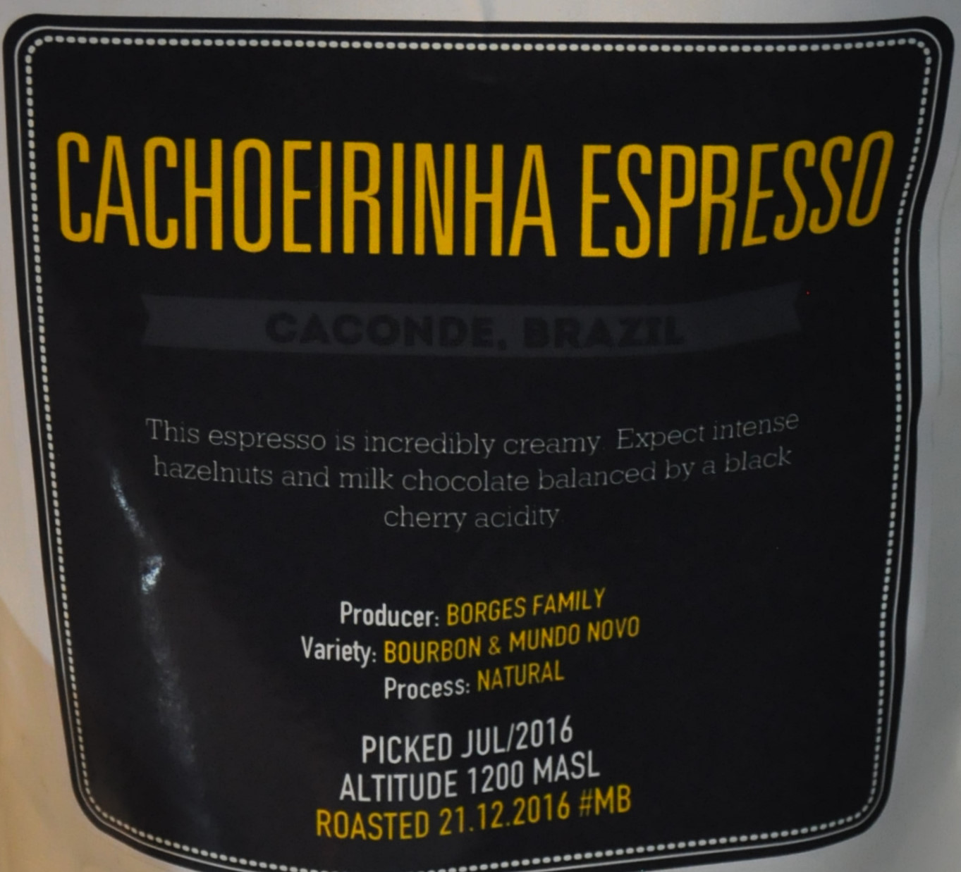 A bag of Cachoeirinha Espresso, roasted by Notes and in the hopper at Flat Cap Borough during my visit in January 2017.