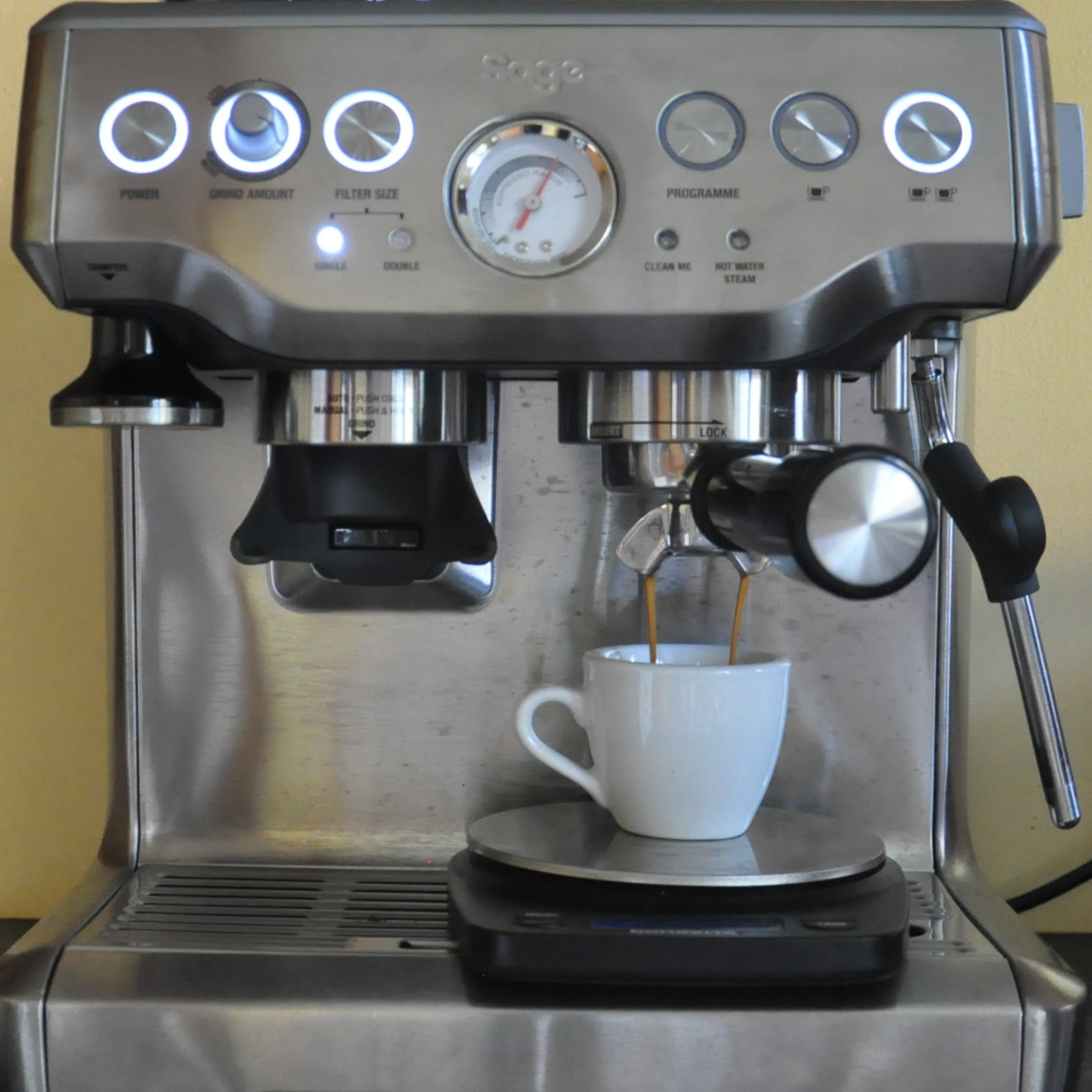 My Sage Barista Express in action, making an espresso with the Coffee Spot cup.