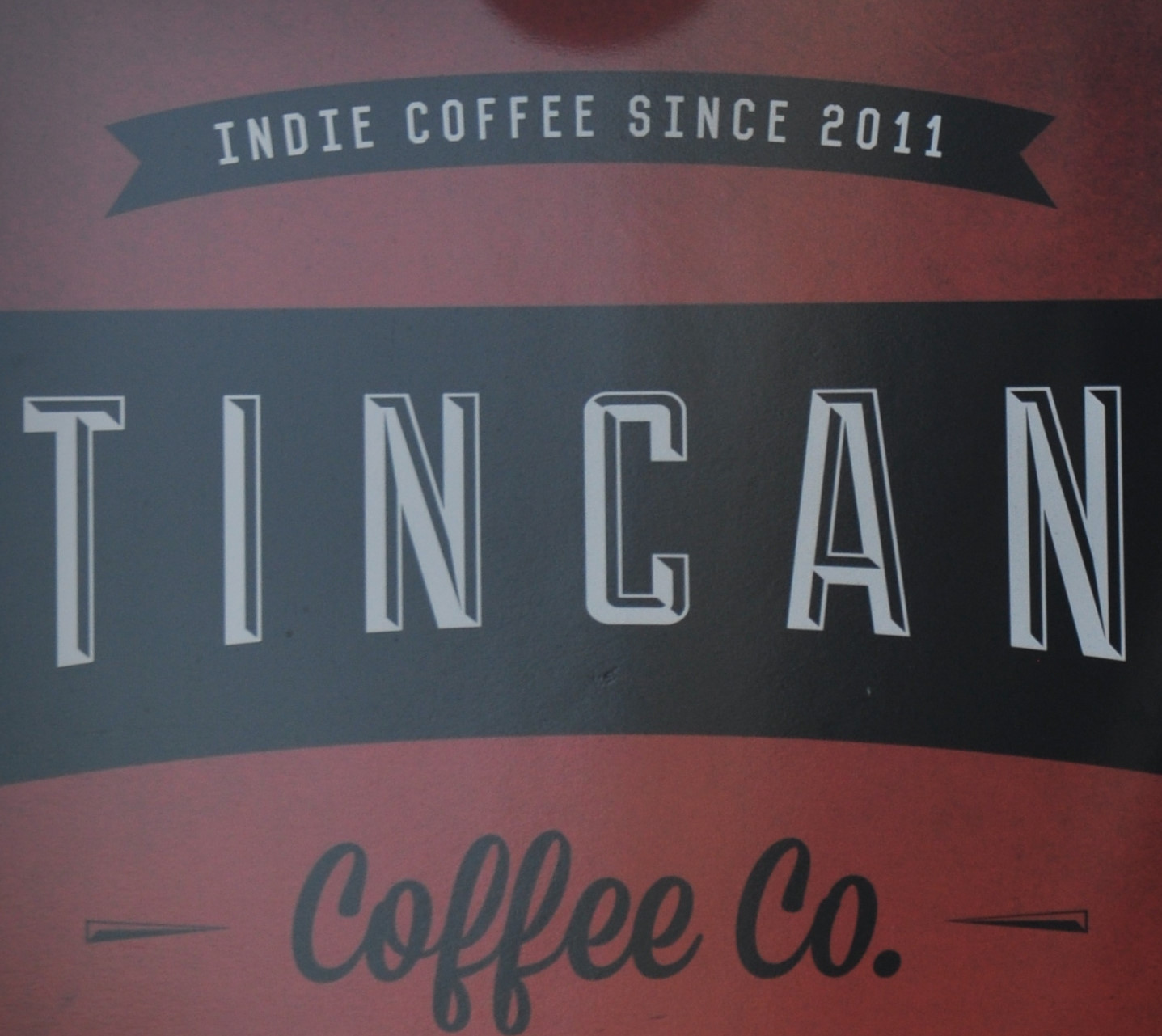 Detail from the sign outside of the Tincan Coffee Co branch on Clare Street, Bristol.