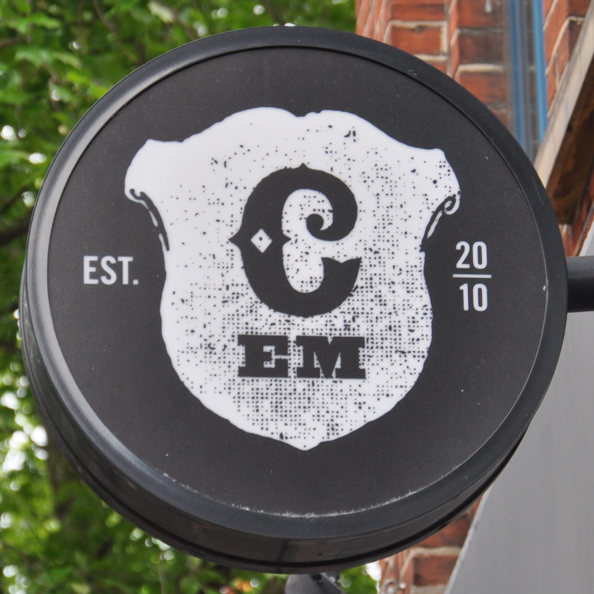 The Caravan logo from the sign outside the original Exmouth Market branch.