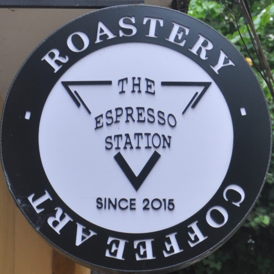 The Espresso Station logo, taken from a sign halfway down the alley which houses it in Hoi An.