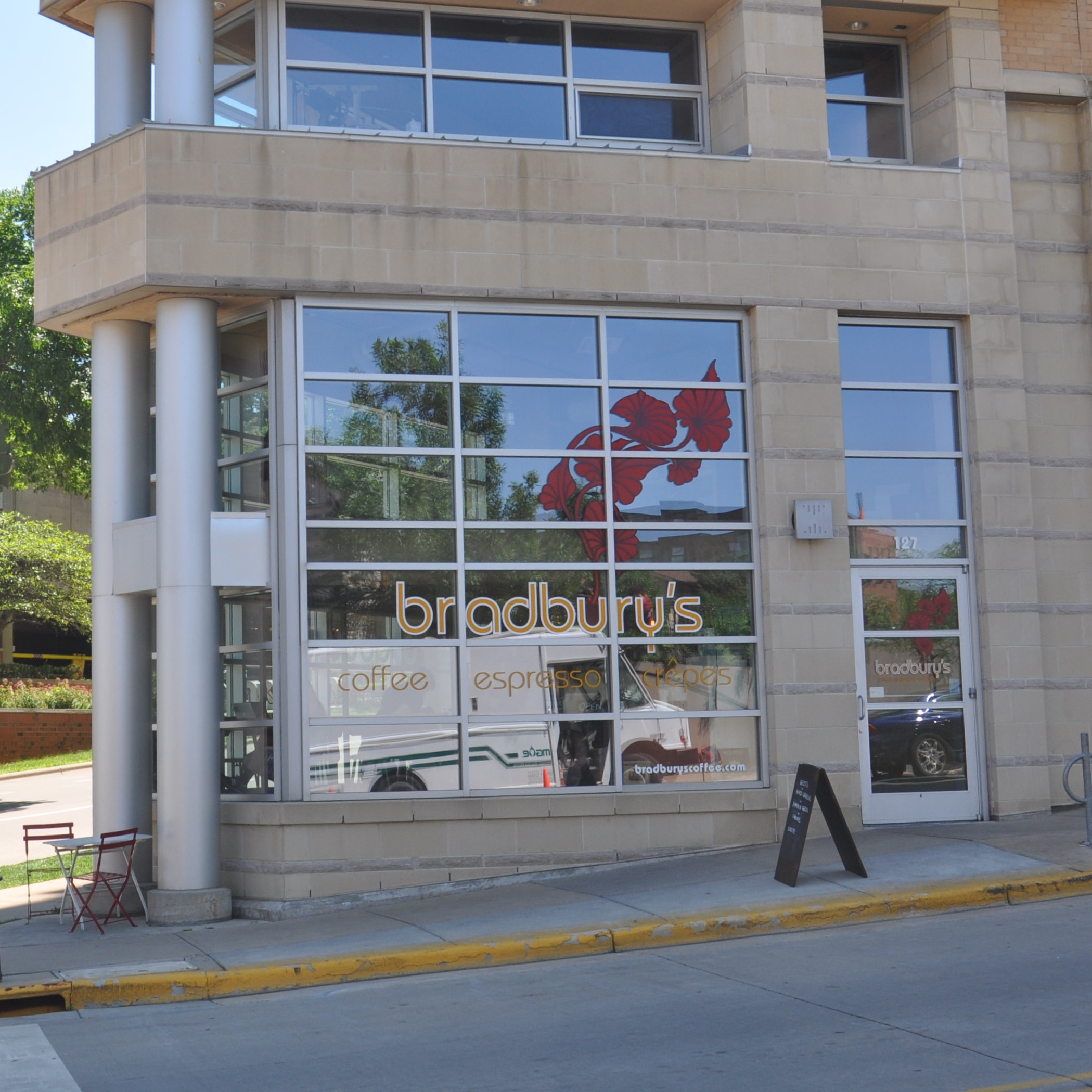 The glass side of Bradbury's on Madison's North Hamilton Street on a sunny day in July.