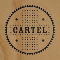 The Cartel Coffee Lab logo from the wooden A-board outside the store in downtown Phoenix.