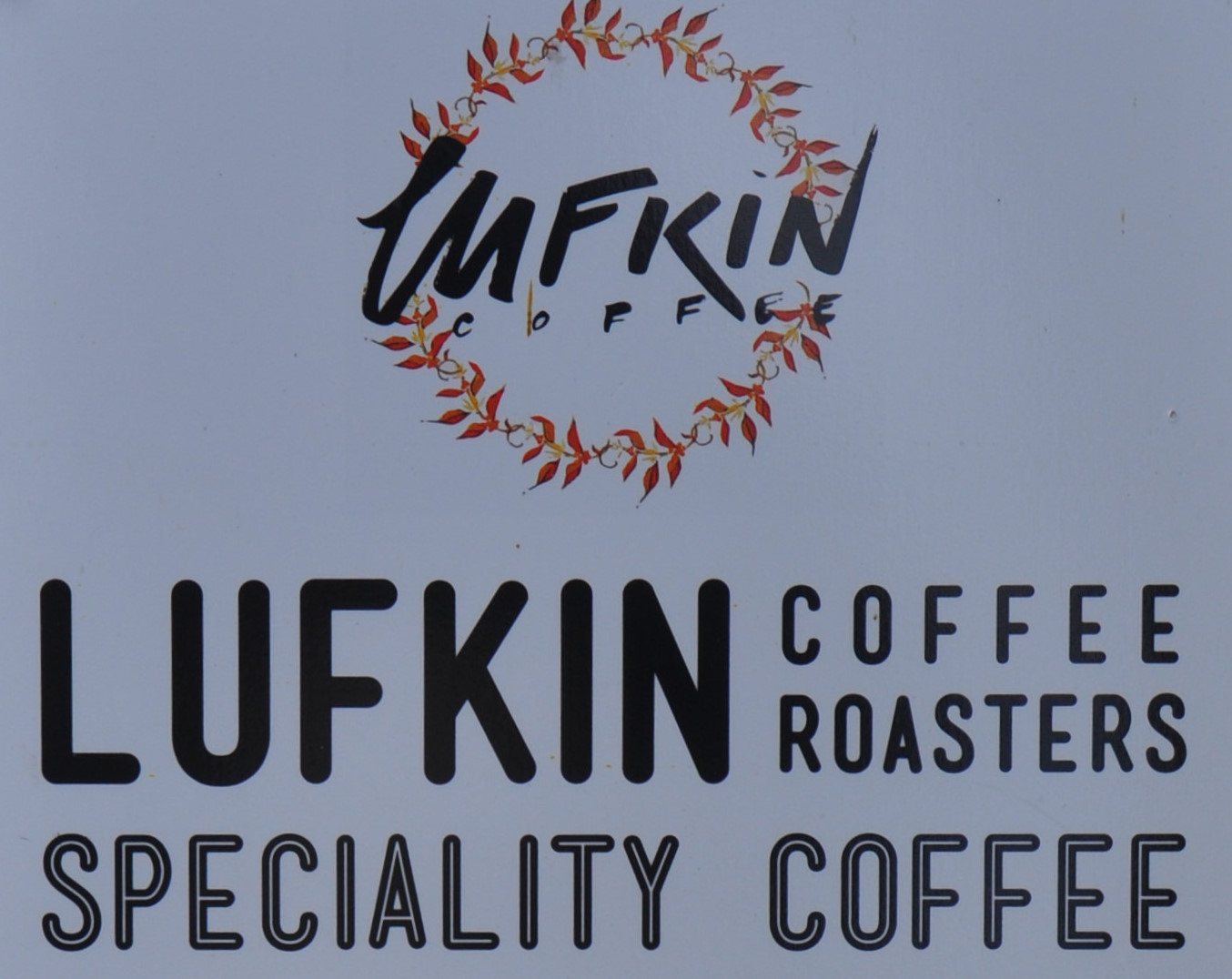 Detail from the top of the sign outside Lufkin Coffee.