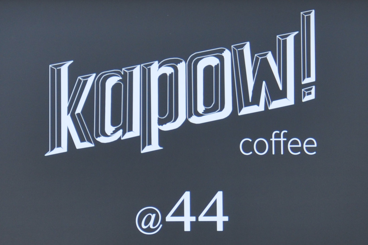 Details from the sign in the window of Kapow! Coffee at 44 The Calls in Leeds.
