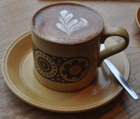 A lovely Kokoa Collection hot chocolate served in a distinctive mug at The Moon & Sixpence in Cockermouth.