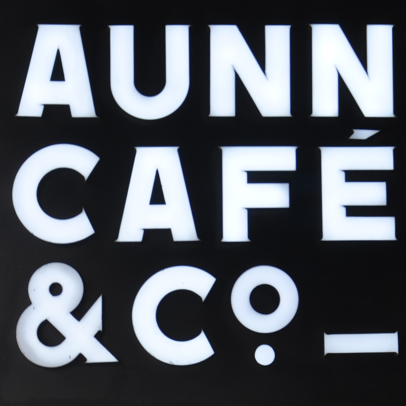 The sign hanging outside AUNN Cafe & Co. in Shanghai