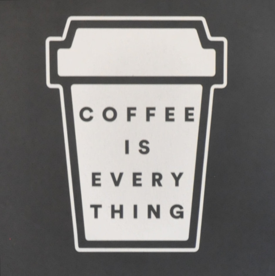 """Coffee is Everything"", written inside the outline of a takeaway coffee cup: detail from a sign inside The Foundation Coffee House in Manchester's Northern Quarter."