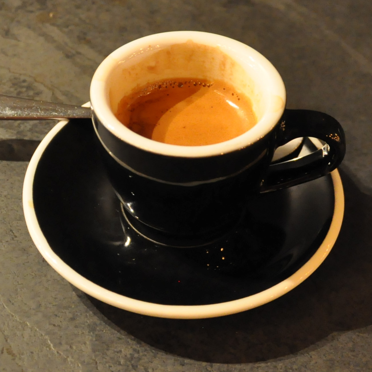 An Indonesian single-origin espresso in a classic black cup, served at 200 Degrees in Leeds.