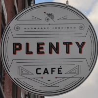 The sign hanging outside Plenty on East Passyunk Avenue, Philadelphia.