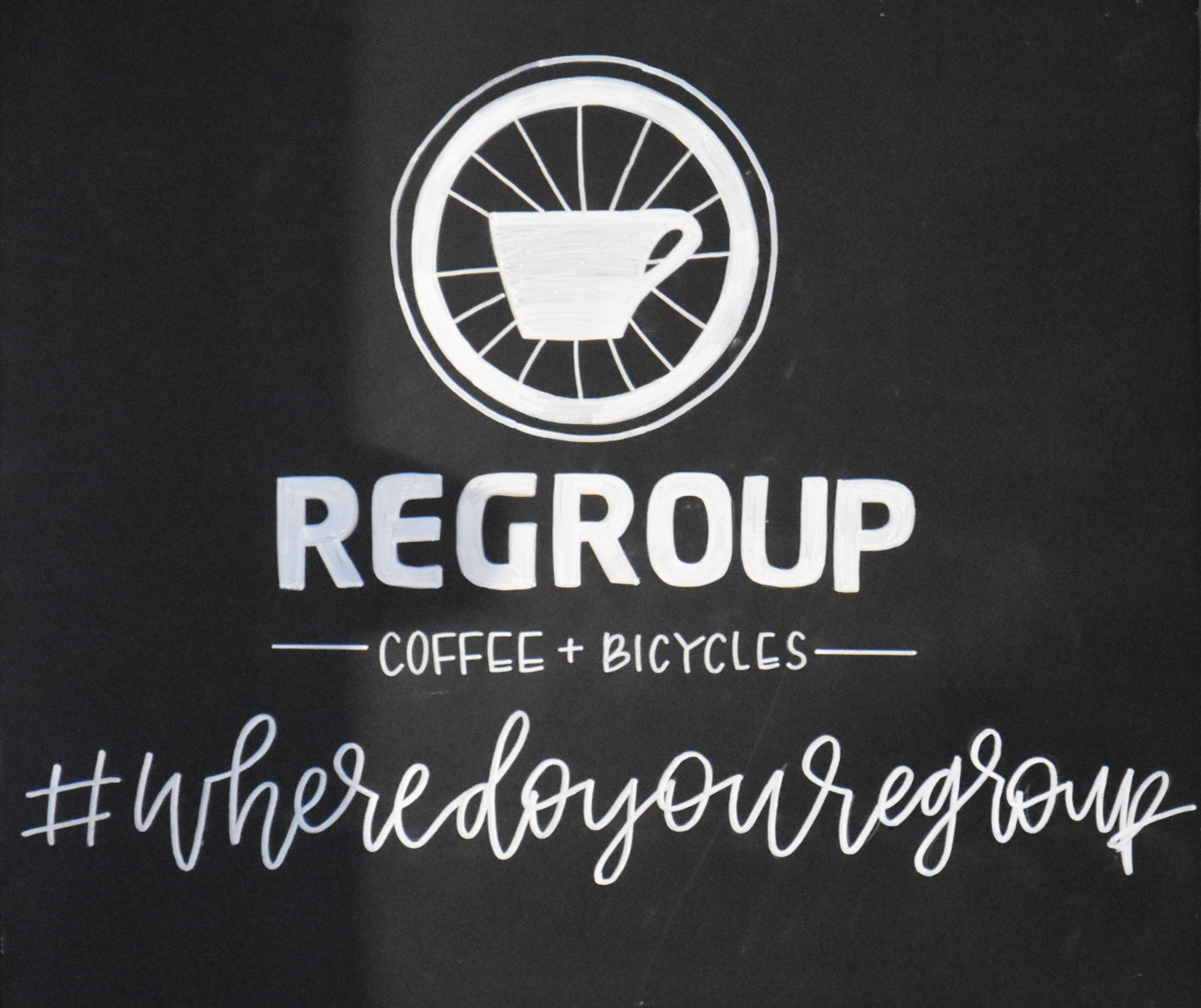 The Regroup Coffee + Bicycles logo, along with its slogan #wheredoyouregroup