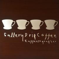 The sign from Gallery Drip Coffee in the Bangkok Arts and Cultural Centre, showing four pour-over cones.