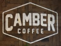 The Camber Coffee logo from the wall behind the counter.