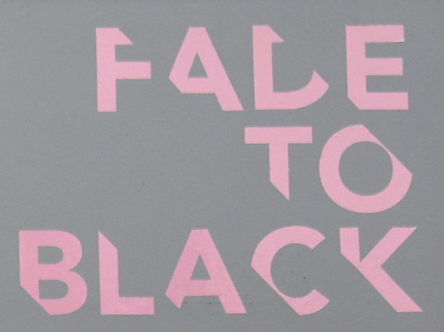 The Fade to Black logo from the front of the store on Uxbridge Road in Hanwell.