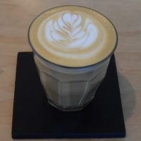 A lovely espresso with milk, served in a glass, at BLK \ MRKT in Traverse City.