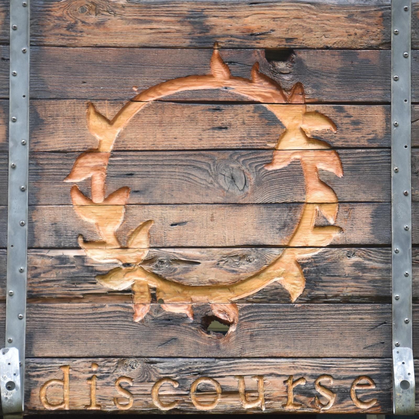 The sign hanging outside Discourse Coffee in Sister Bay, Door County.