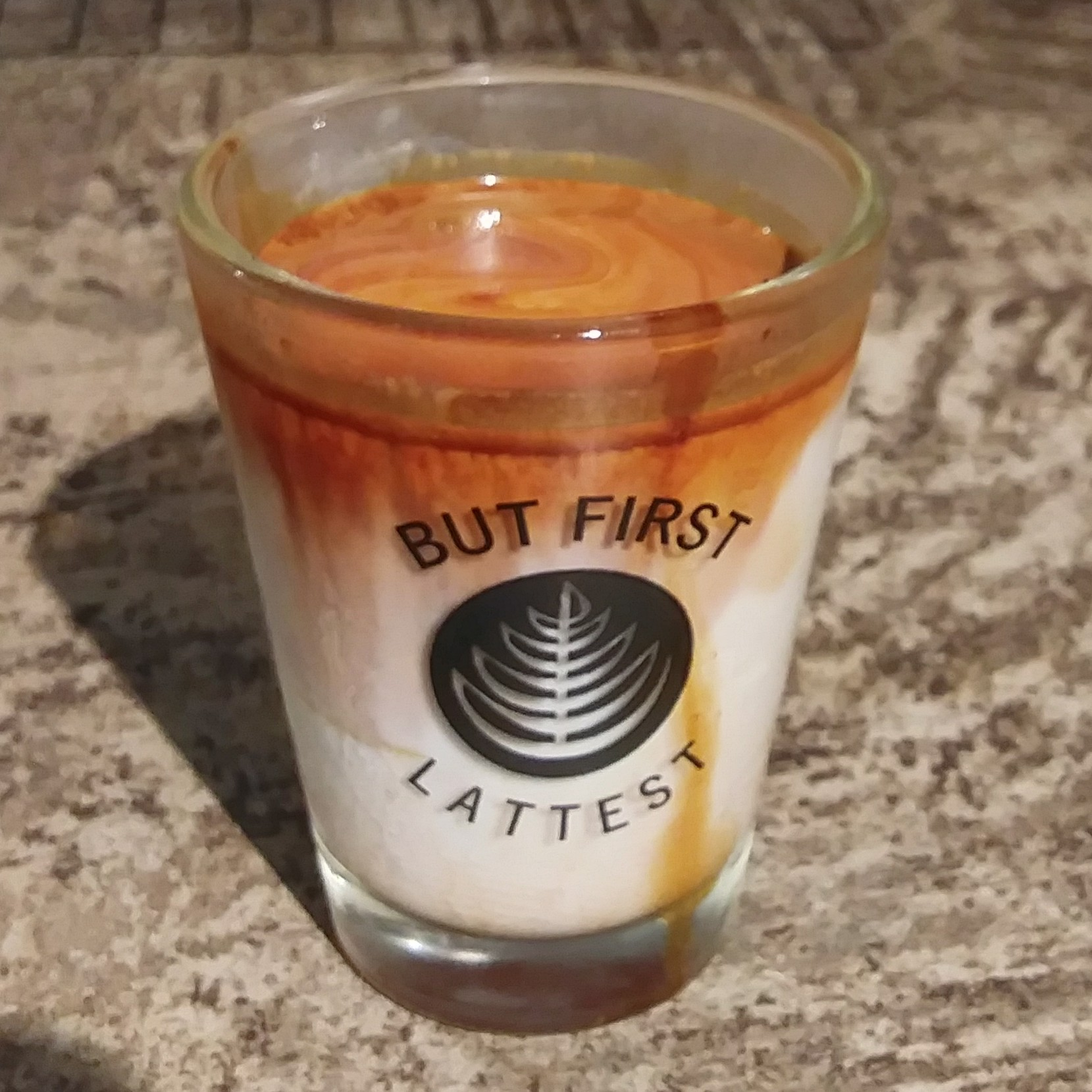 The eponymous Lattest, the signature drink of Lattest in Omotesando, Tokyo: a single espresso shot extracted into a glass of chilled milk.