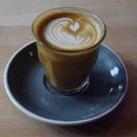 My flat white, in a glass, at Paquebot Mont-Royal, made with the Waykan Guatemalan single-origin espresso.