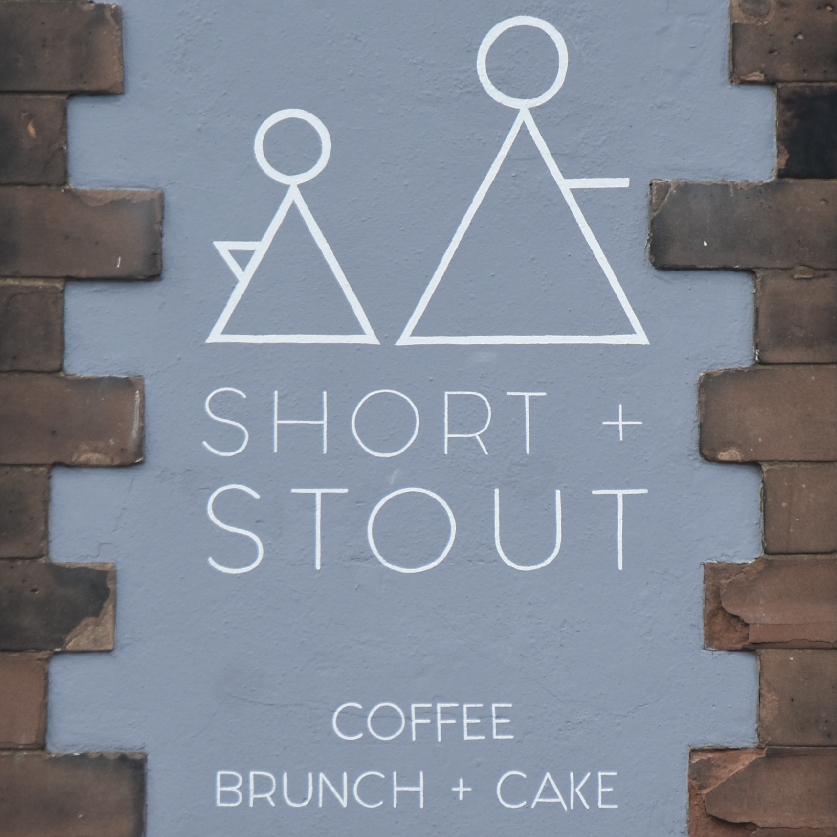The Short + Stout logo from above the door of the shop in Hoole.
