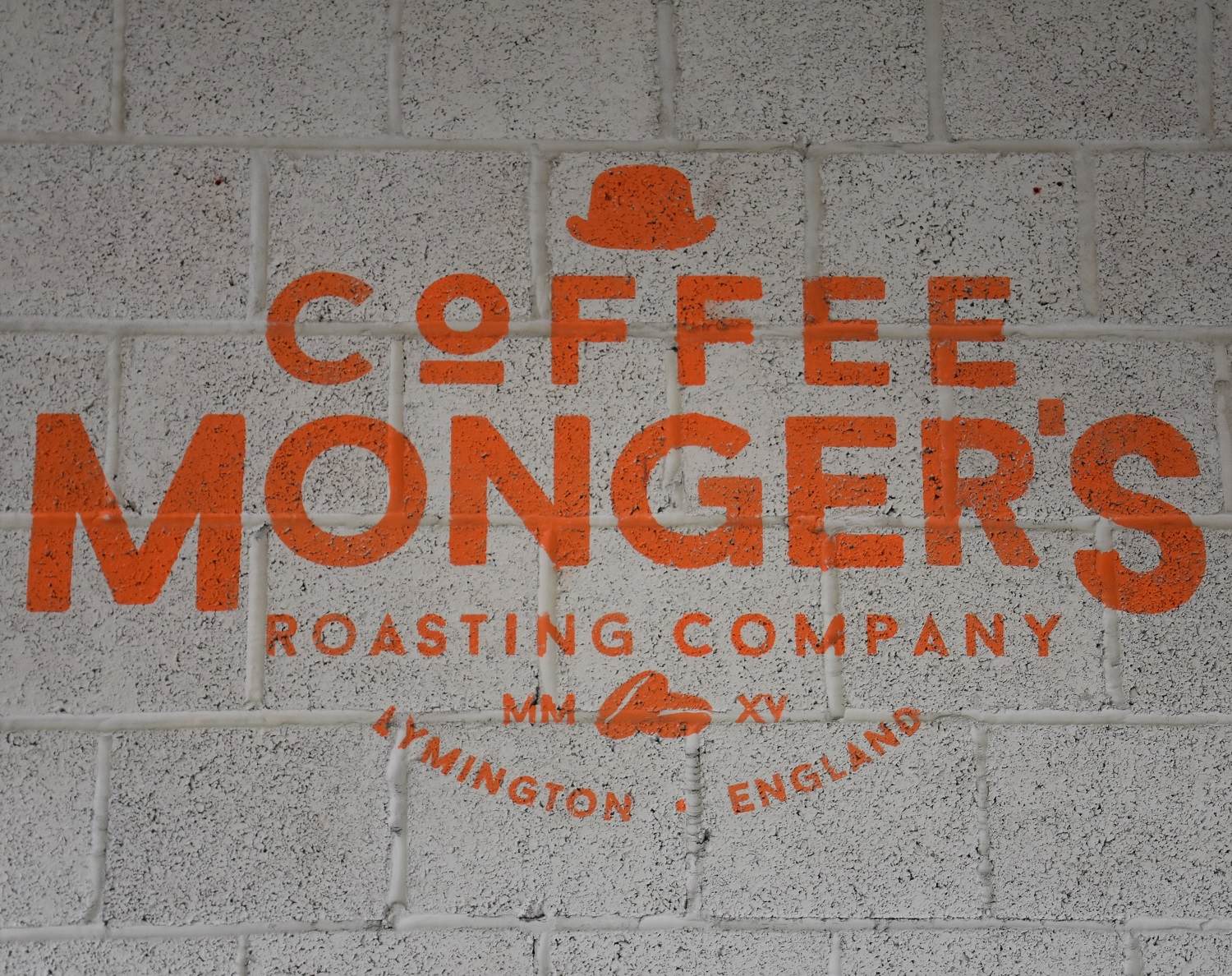 The Coffee Monger's Roasting Company's logo from the wall of the roastery in Lymington, Hampshire.