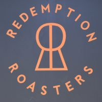 The Redemption Roasters logo from the front wall of the Lamb's Conduit Street coffee shop.