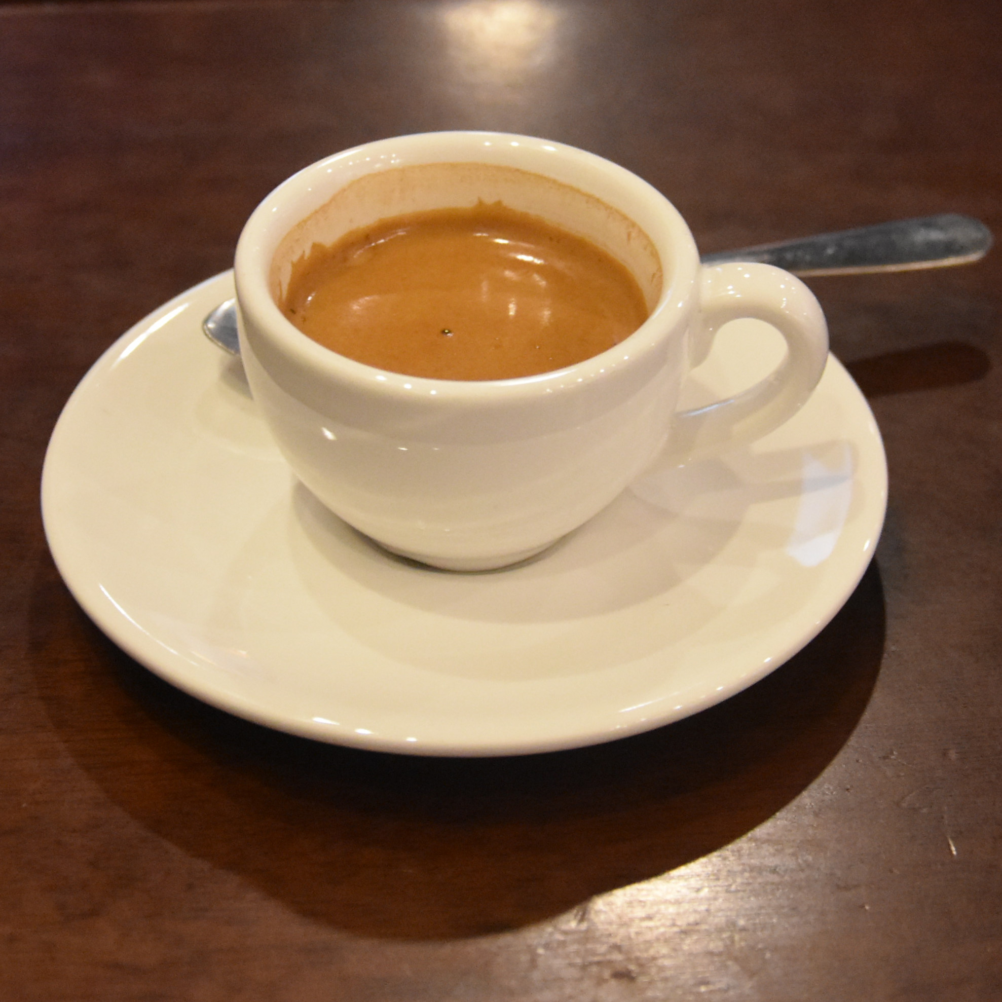 An espresso, served in a class white cup, at Firecreek Big Park in the Village of Oak Creek in Arizona.