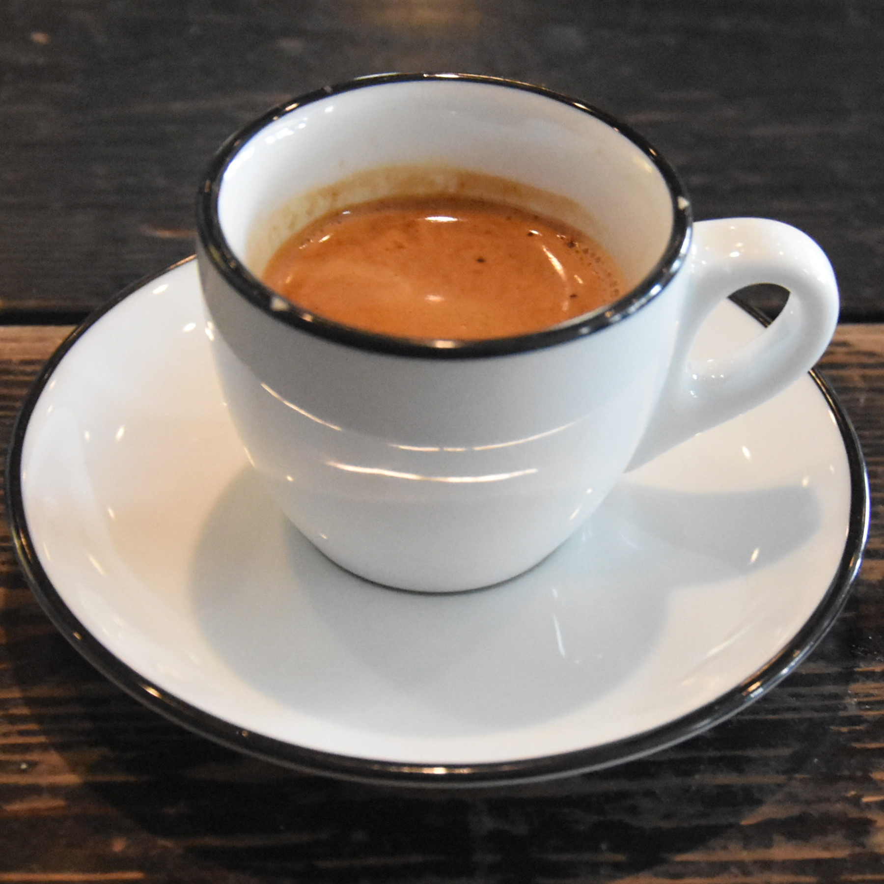 A Burundi single-origin espresso, served in a classic white cup at Gaslight Coffee Roasters in Chicago.