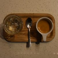 My espresso, made with the 120PSI house-blend at Presta Coffee, Mercado San Augustin, and beautifully presented on a wooden tray with a glass of sparkling water.