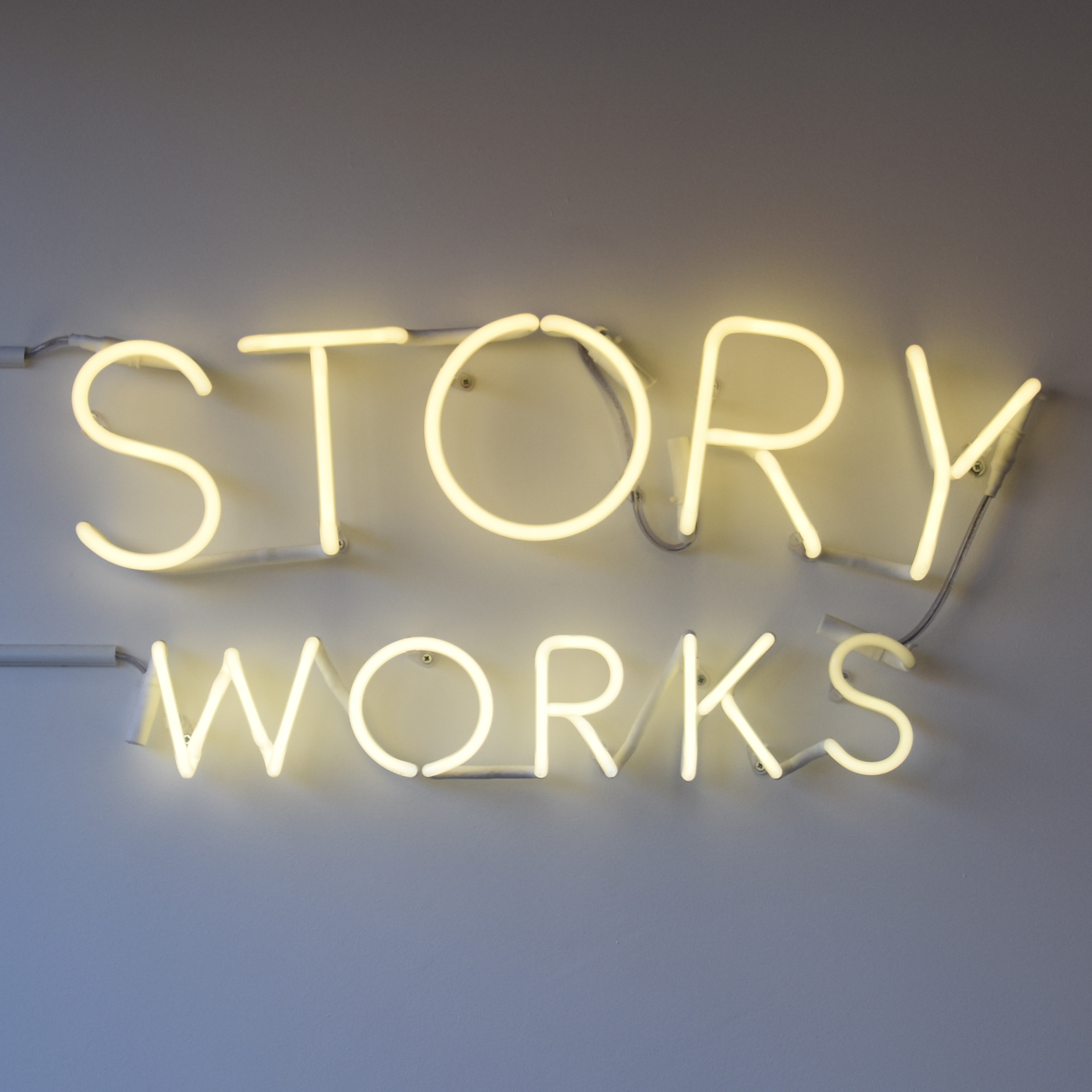 "The sign says it all: ""Story Works"", from the wall of Story Works by Clapham Junction."
