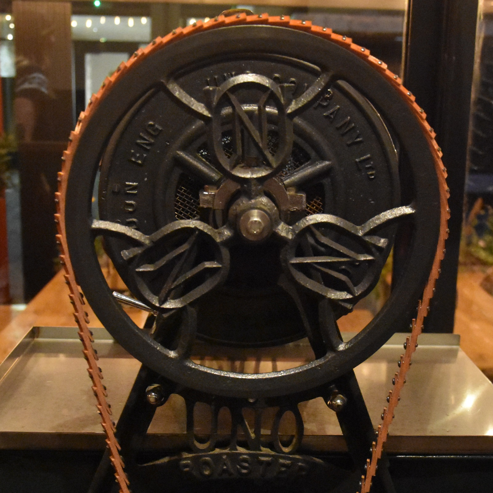 Details of the main drive wheel of the 100 year old, fully working Uno coffee roaster at Atkinsons in Mackie Mayor in Manchester.