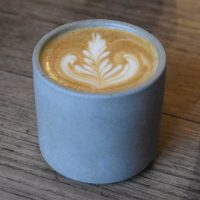 A lovely flat white, made with a Colombian single-origin from The Good Coffee Cartel, and served in handless ceramic cup at Glasgow's East Coffee Company.