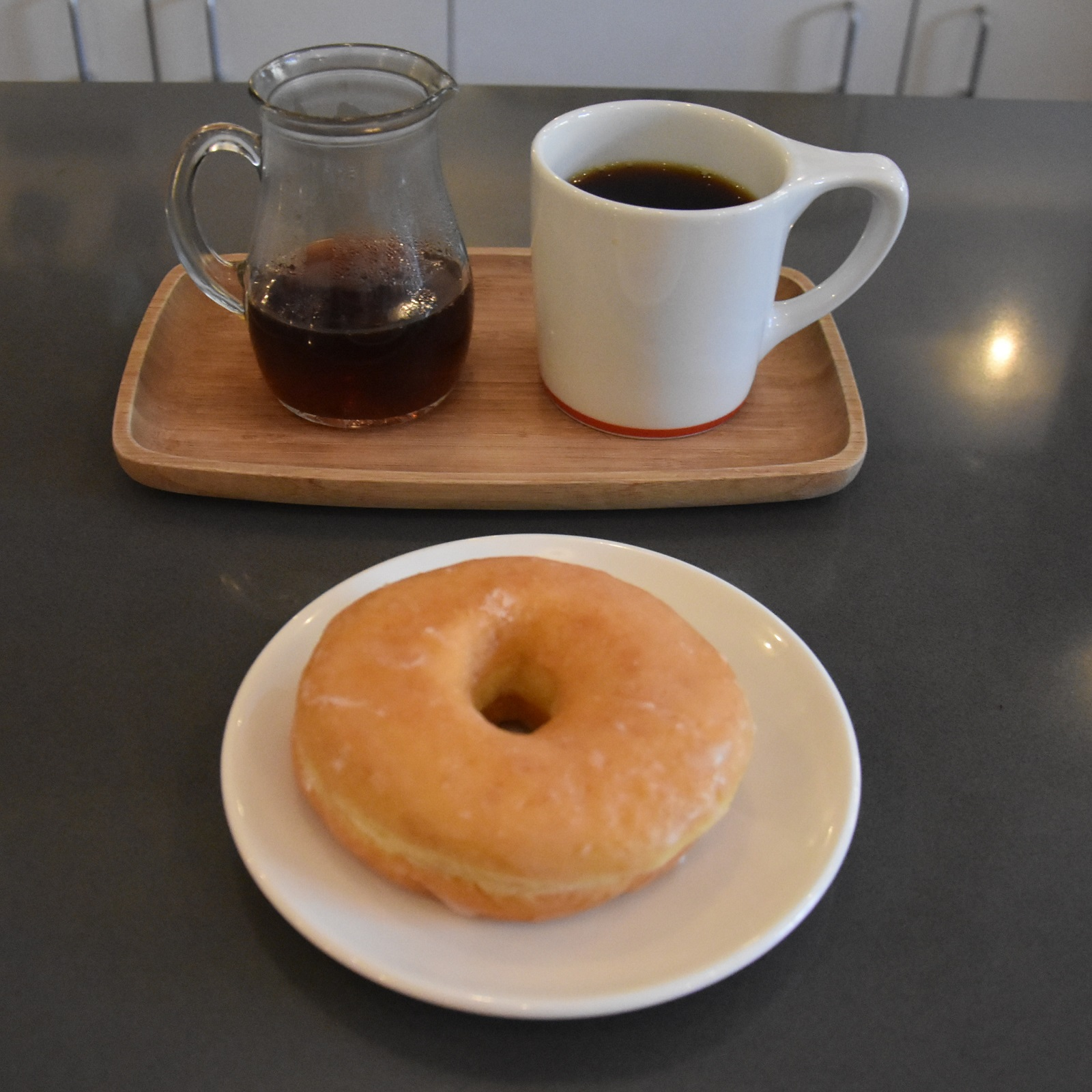 A batch-brew of an El Salvador single-origin, served in a carafe with a mug on the side, plus a lovely, honey-glazed doughnut, at Intelligentsia, Logan Square.