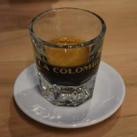 My espresso, a single-origin Papua New Guinea, served in a glass at the Gold Coast branch of La Colombe.