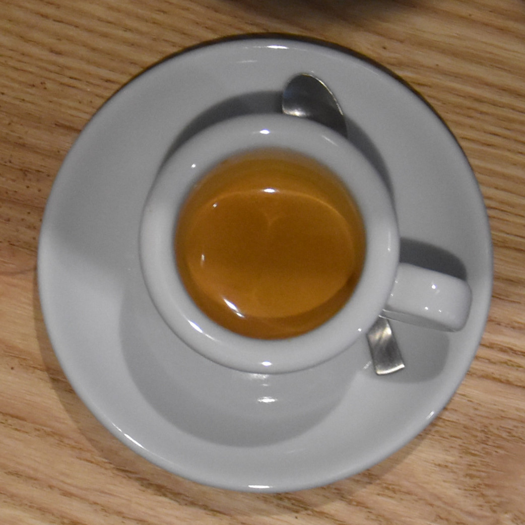 A lovely espresso in a classic white cup, made with the bespoke house-blend at Omotesando Koffee, London.