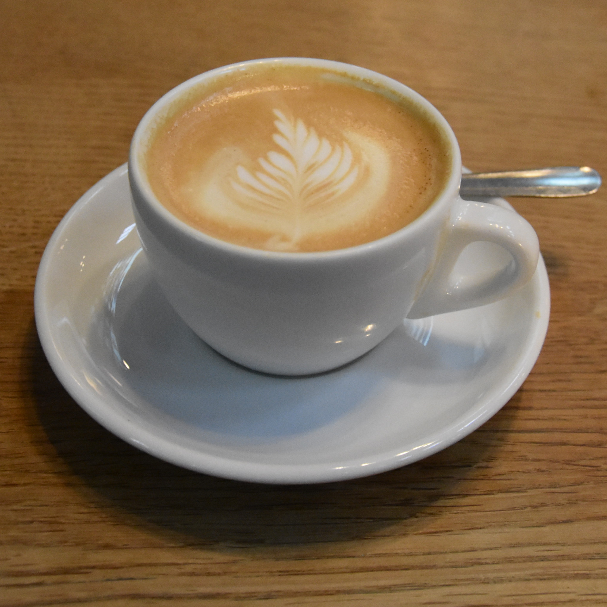 A lovely flat white made with the Up Hill espresso blend from Mission Coffee Works at Host Cafe in St Mary Aldermary Church, London