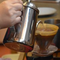 My pour-over being made at the counter at Rumors Coffee Roasters on Xingguo Road, Shanghai.