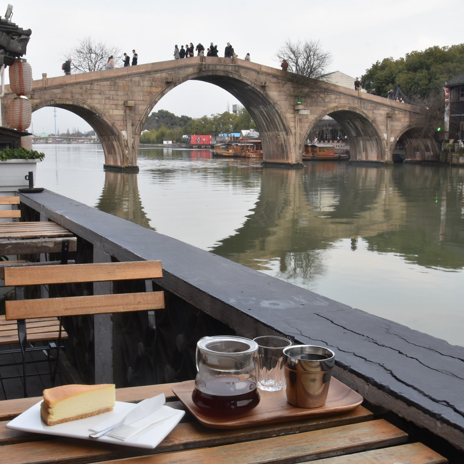 My coffee, overlooking the five stone arches of Fangsheng Bridge in Zhujiajiao from the back terrace of The Point.
