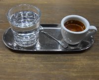 My espresso, plus a glass of water, beautifully-presented on a metal tray, at Shanghai's UNDEF/NE.