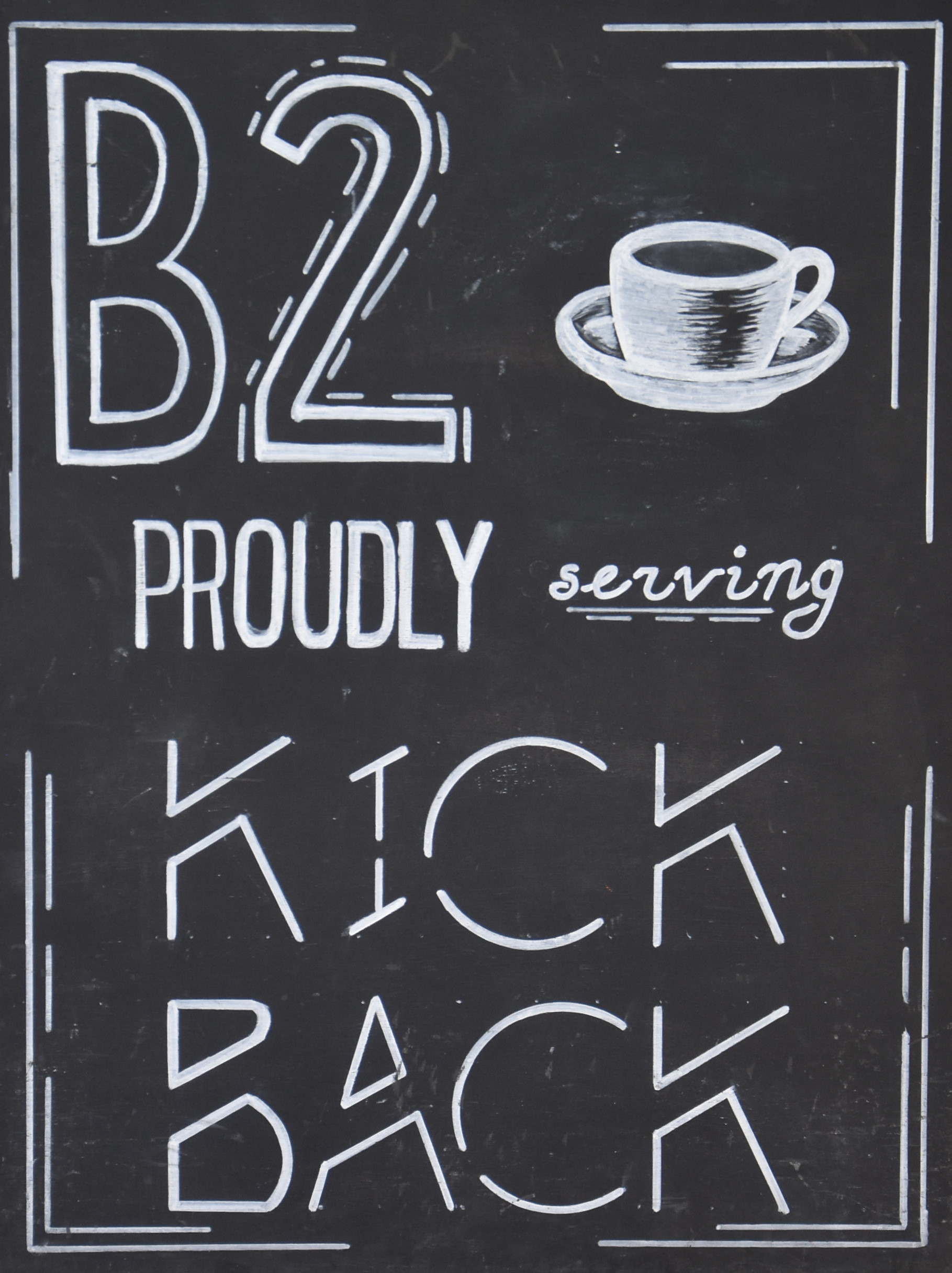 """B2 PROUDLY serving KICK BACK"", taken from the board outside B2 in San Pedro Square Market."