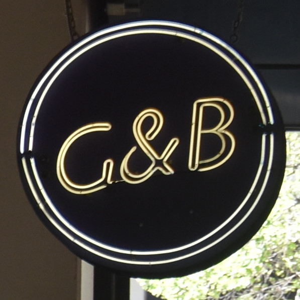 The G & B Coffee sign, hanging high above the rear of Los Angeles Central Market.