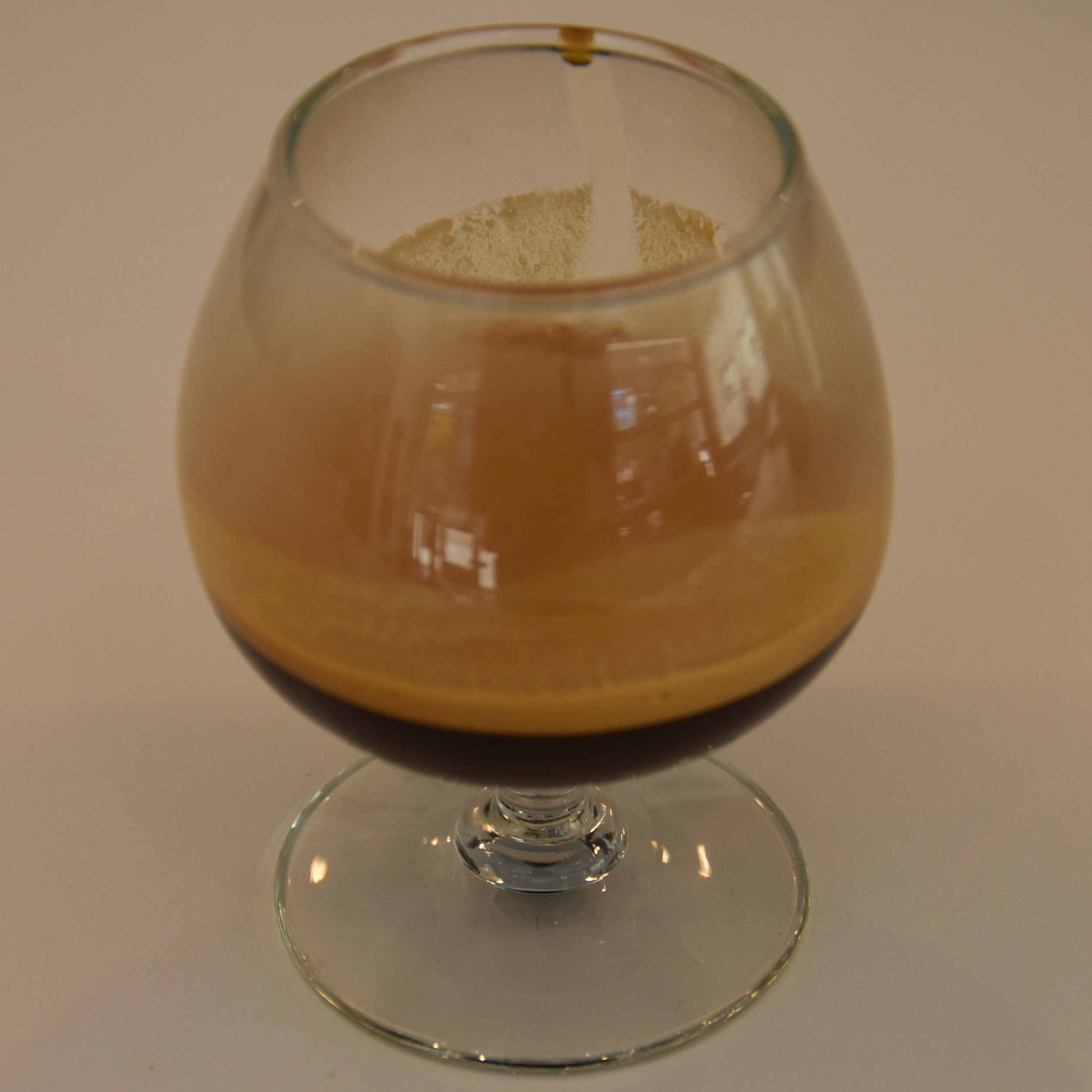 An exclusive naturally-occurring varietal from El Salvador, served as an espresso in a snifter glass at Madcap, Fulton in Grand Rapids.