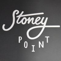 The logo / name of Stoney Point, written on the black board behind the counter.