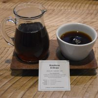 A Honduran single-origin pour-over served at Verve Coffee Roasters on Spring Street, Los Angeles, The coffee comes in a carafe, cup on the side, presented on a wooden tray with a card giving details of the beans.
