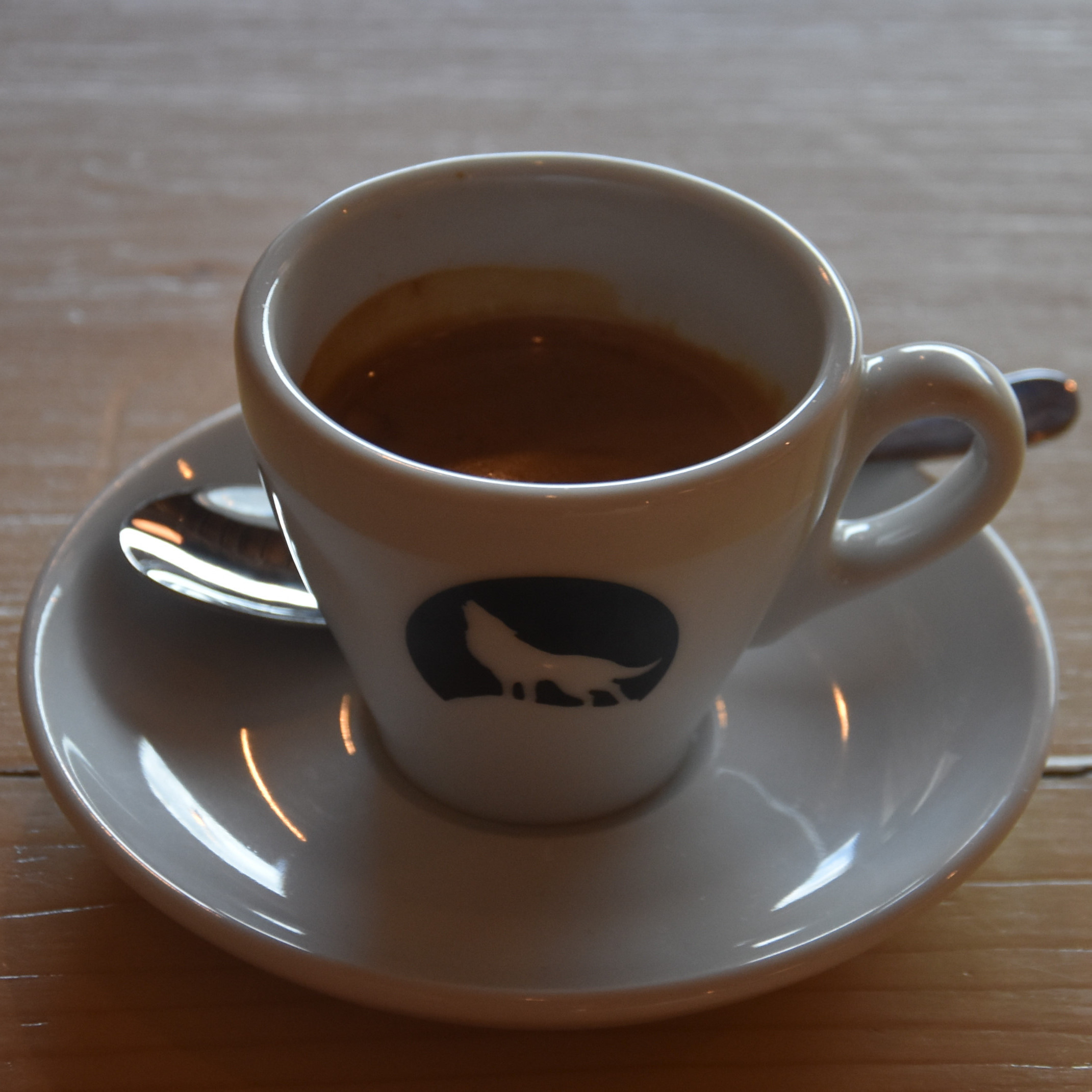 An El Salvador single-origin espresso from Clifton Coffee Roasters in a classic white espresso at Big Bad Wolf Coffee.