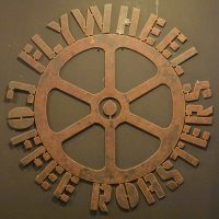The Flywheel Coffee Roasters logo from the wall of the coffee shop in San Francisco.