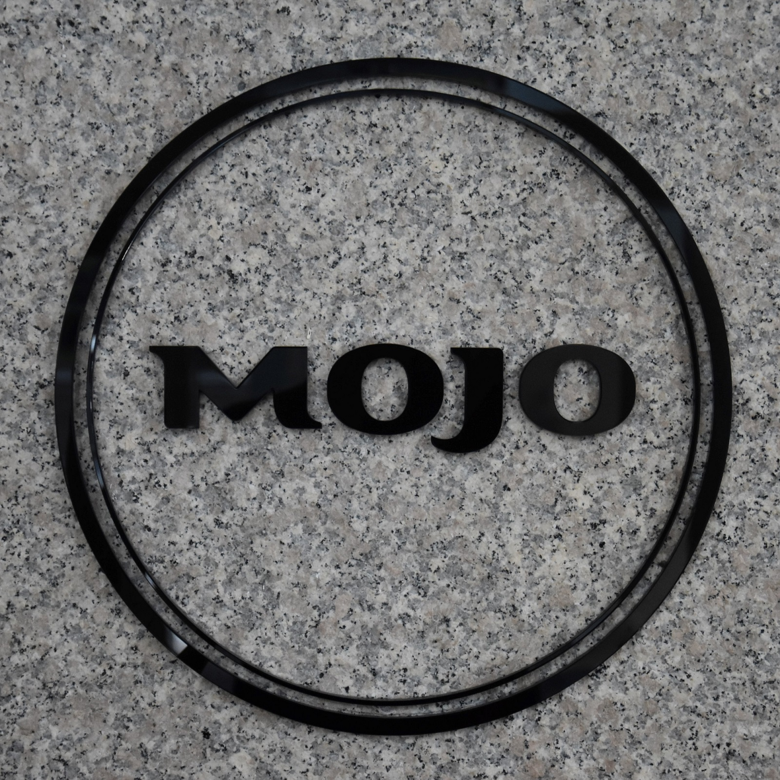 The Mojo logo from the wall of its first Chicago branch, 200 South Wacker.
