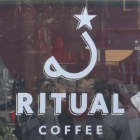 The Ritual Coffee logo in the window of the Hayes Valley branch.