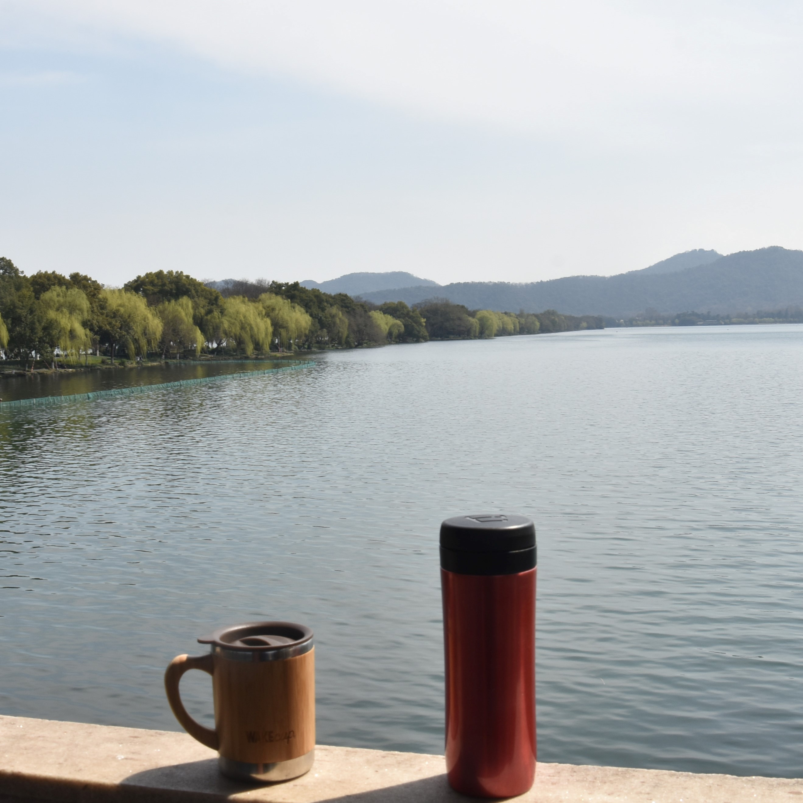 My coffee, in the shape of my Global WAKEcup and Espro Therma Pres, overlook the West Lake in Hangzhou from the Fair Rainbow Bridge on a recent trip to China.