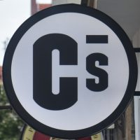 The Coffee Source logo from the sign outside the shop in Prague.
