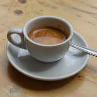 A single-origin Colombian espresso from Workshop in a classic white cup at Knockbox Coffee.